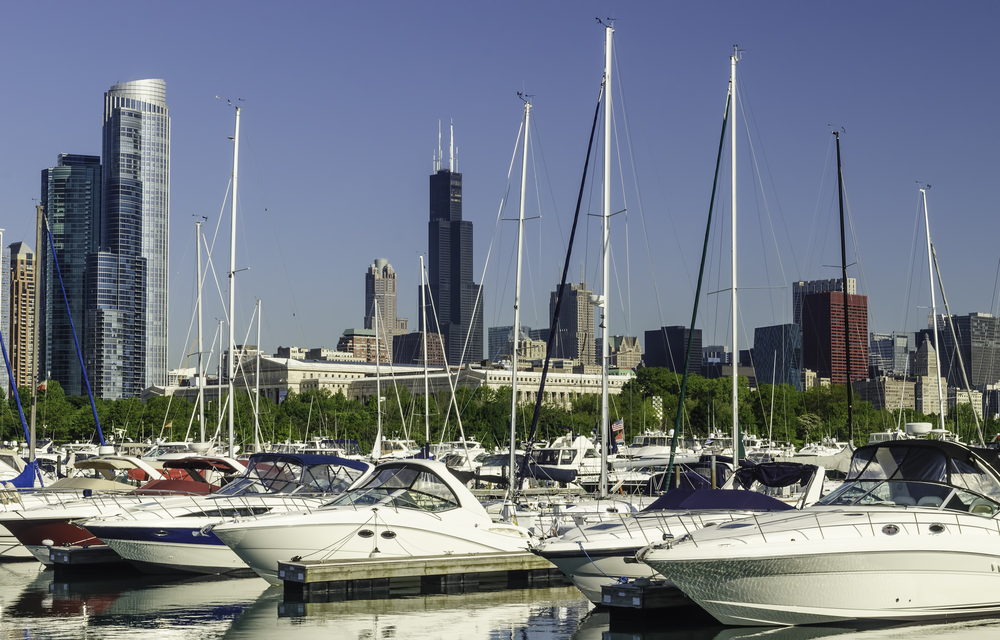 Urban marina skyline Yachts in Burnham Harbor in Chicago, Illinois, USA, with landmarks (including Willis Tower, once the tallest building in the world) in the distance, early in June