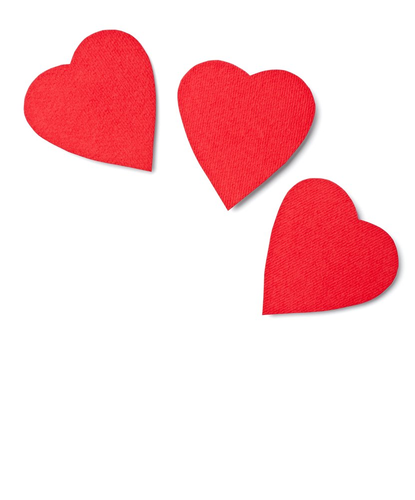 close up of paper heart shapes on white background